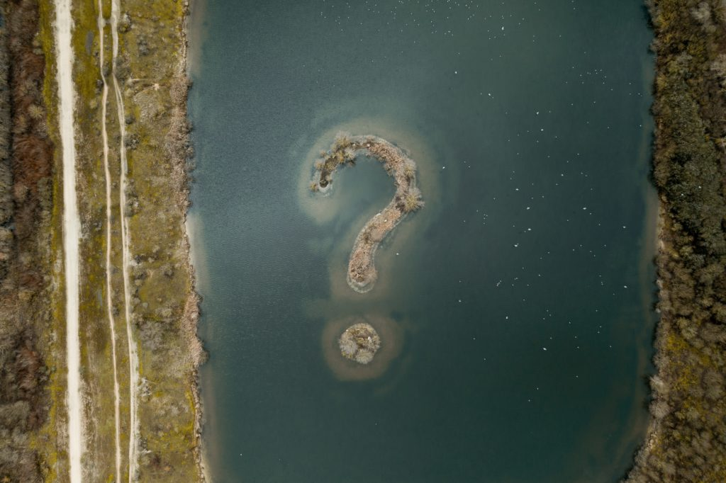 river with question mark as an island