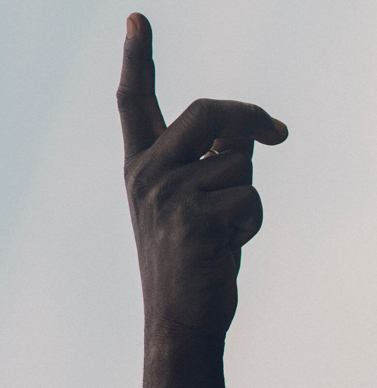 a finger in the air to stop people talking when not understood
